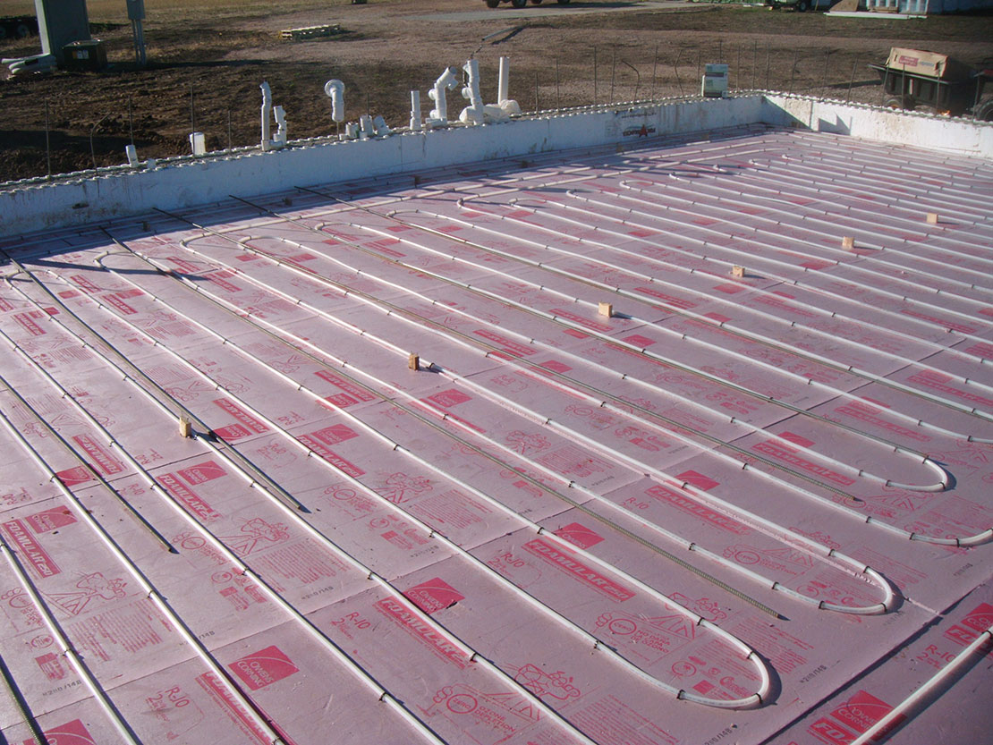 Viking Mechanical installing radiant heating in a new building.